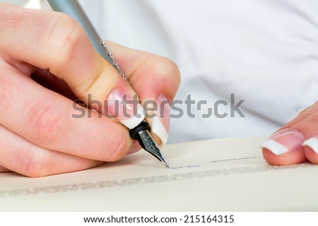 a woman signs a contract or a will with a fountain pen.