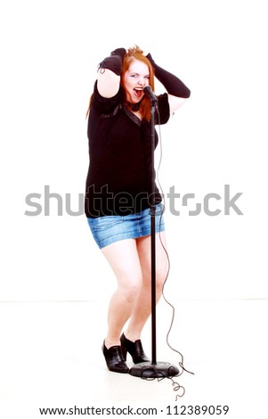 A woman singing really intensely - stock photo