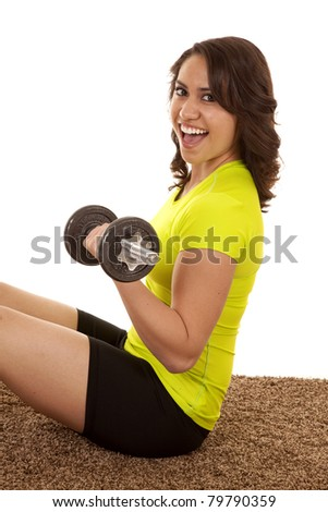 A woman sitting down working out with weights.