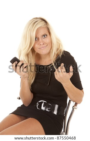 a woman sitting in a black dress with a shocked expression of what just happened on her face.