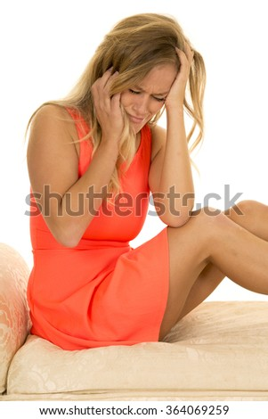 a woman sitting on a sofa crying because she is upset.