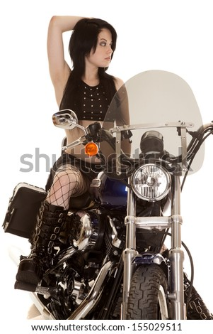A woman sitting on her road bike looking over to the side - stock photo