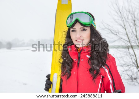A woman skiing on the ski run in the Alps - stock photo