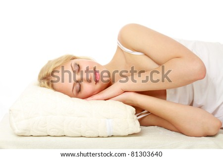 A woman sleeping on a pillow on white background