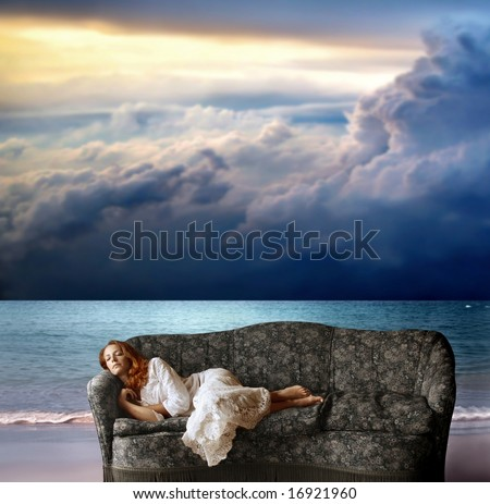 a woman sleeping on the sofa on the beach