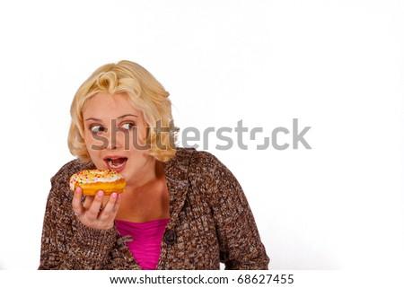 A woman sneaks a doughnut - stock photo