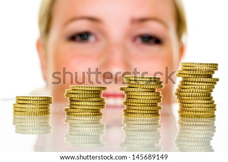 a woman stacks coins. save money for the future. - stock photo