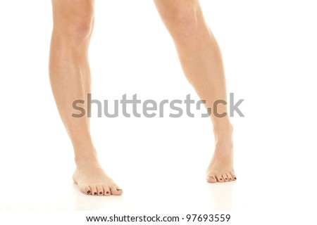 a woman standing on her feet in a fun pose - stock photo