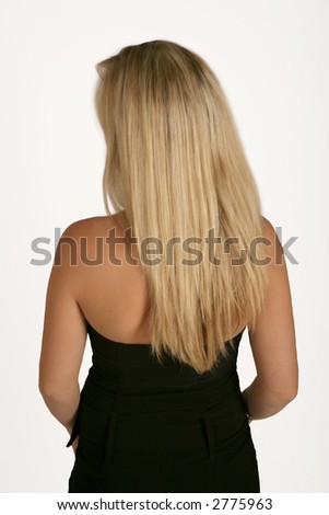a woman standing with her back to the camera - stock photo