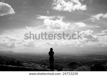 A woman staring out across at the world. - stock photo