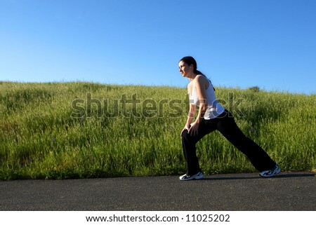 A woman stretching before a workout - stock photo