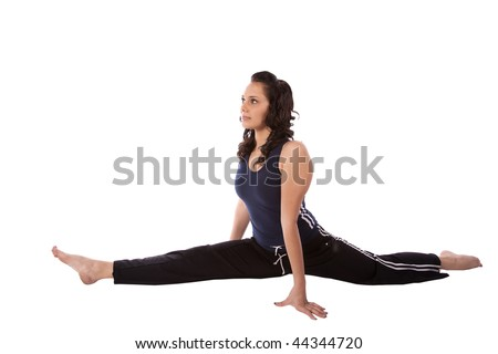 A woman stretching out while doing the splits.