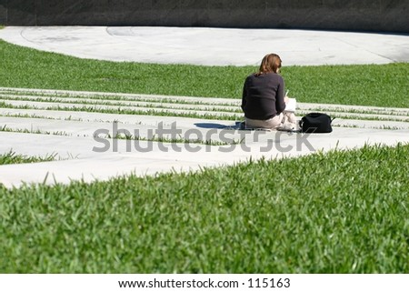 A woman studying between classes. - stock photo