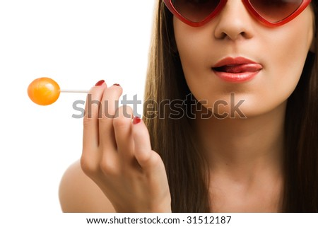 A woman sucking a lollipop on a white background - stock photo