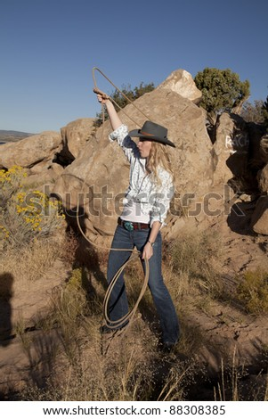 A woman swinging her rope in the outdoors. - stock photo