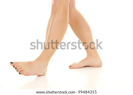 A woman taking a walk in her bare feet. - stock photo