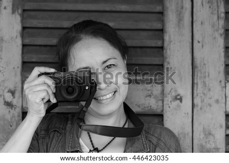 A woman taking pictures  with her camera.