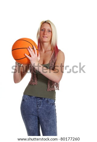 A woman throwing a basketball