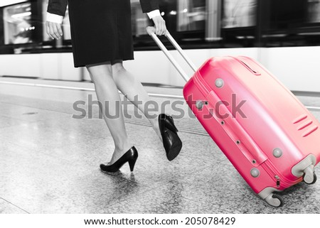 a woman traveling on a station - stock photo