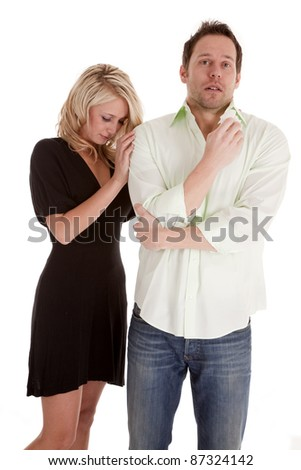 A woman trying to comfort her man as he is crying in his tissue. - stock photo