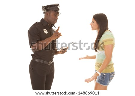 A woman trying to talk her way out of a ticket, that the policeman is going to give her. - stock photo