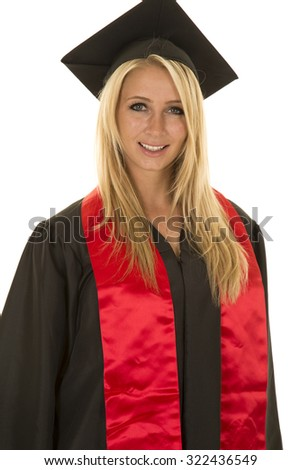 a woman up close in her graduation gown with a smile on her face. - stock photo
