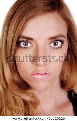 A woman up close looks startled. - stock photo