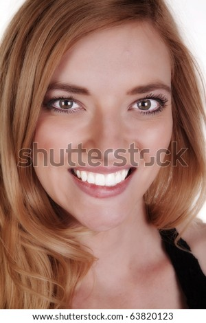 A woman up close smiling. - stock photo
