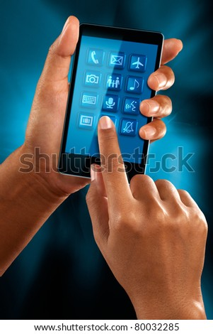 A woman use a mobile phone to select a application - stock photo