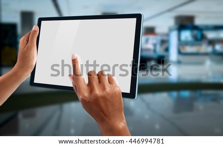 A woman using a tablet to make online shopping