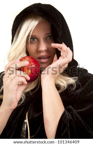 A woman wearing a cloak holding on to an apple with a intense expression on her face.