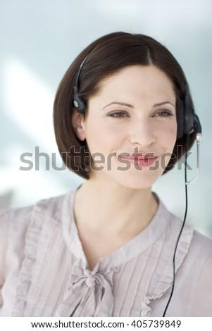A woman wearing a headset - stock photo