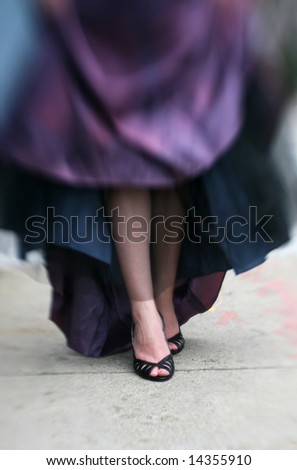 a woman wearing black heels and a prom dress with special focus