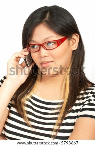 a woman wearing red eyeglasses talking on the phone