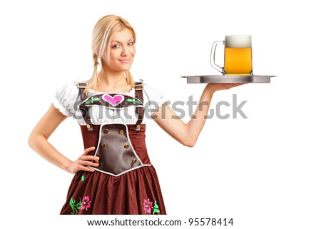 A woman wearing traditional costume and holding a tray with beer glass isolated on white background
