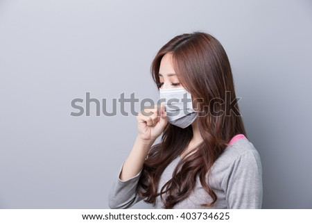 A Woman wears a mask and coughing, illness,profie,  asian beauty,gray background - stock photo