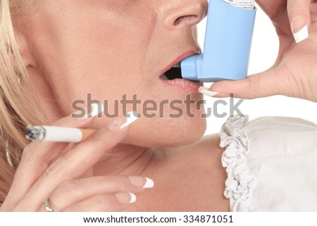 A woman who holding a cigarette in front of a white background