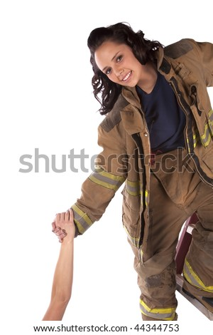 A woman who is a fire fighter reaching down to help someone in need. - stock photo