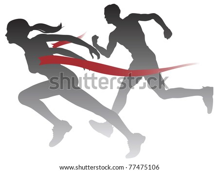 A woman winning a race breaking through the finish line. - stock photo