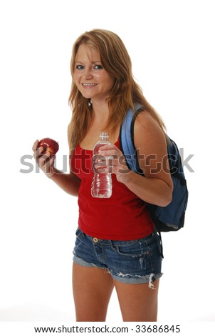A woman with a backpack holding an apple and a bottle of water
