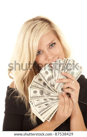 A woman with a fan of money with a smile on her lips. - stock photo