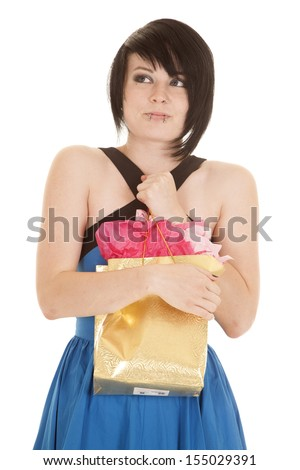 A woman with a funny expression on her face holding on to her gift.