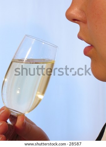 A woman with a glass of sparkling wine.