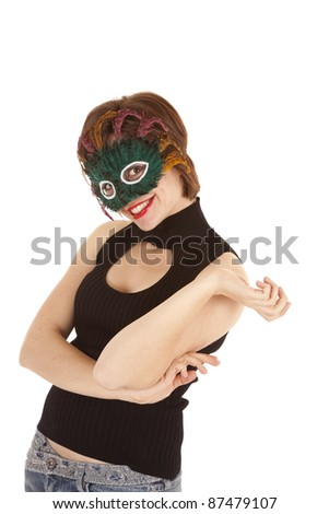 A woman with a green mask on with a crazy expression on her face. - stock photo