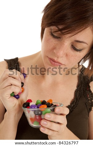 A woman with a handful of jelly beans.