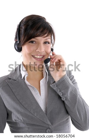 a woman with a headset in a call center or a office - stock photo
