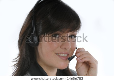 a woman with a headset in a callcenter or a office - stock photo