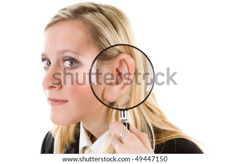 A woman with a magnifying glass next to her ear. Please listen.