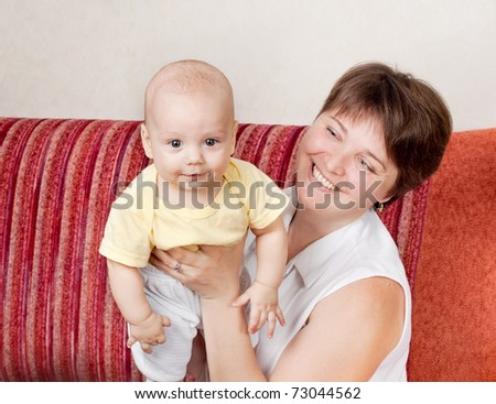 A woman with a newborn baby