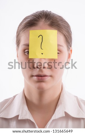 A woman with a piece of paper on forehead